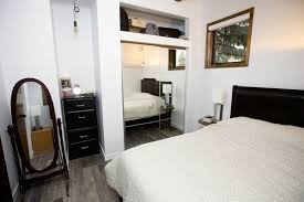Bedroom, Bed, Dresser, Ceiling Lighting, Pendant Lighting, And Vinyl Floor  Calder