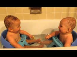 twins taking first bath together