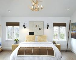 wall lighting bedroom. Wall Lighting For Bedroom Example Of A Trendy Light Wood Floor Design In With White Walls Lights Nz