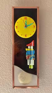 deco fusion pendulum glass wall clock
