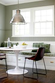 white tulip table with marble top and bench seating