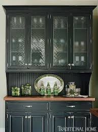 black kitchen cabinets with glass inserts photo 14