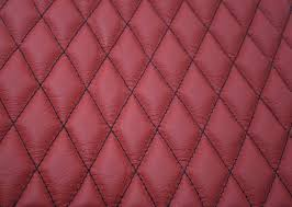 Quilted Leather Seat Swatch | Trim Technik & Quilted red leather with black single stitching Adamdwight.com
