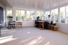 This spacious sun porch is a great place for a pool table