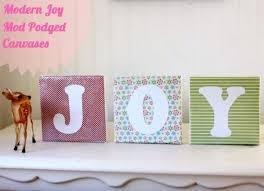 <b>DIY</b> Christmas Decor - <b>Modern</b> JOY <b>Canvases</b> - Mod Podge Rocks