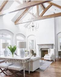 a vaulted ceiling with skylights floods the room with natural light