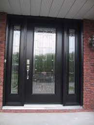 bevelled glass panel black front door frame also brick wall exterior accent feats antique wall lamp