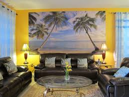 wide beach wall painting in beach themed living room with leather sofas and glass top table beach style living room furniture