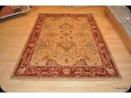 5 x 7 handmade wool area rug gold background