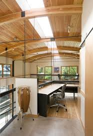 herman miller home office. modern home office with wood panel ceiling skylight aeron chair herman miller