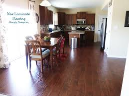 laying and installing laminate floors tutorial photo of finished kitchen with laminate wood floors