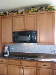 Tin Backsplashes For Kitchens White Kitchen Cabinet With Top Knobs And Tin Backsplash Also