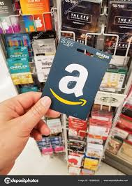 montreal canada november 7 2017 amazon gift card in a hand on gift cards background amazon is an american electronic merce and cloud puting