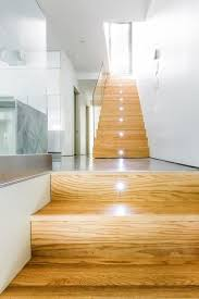 staircase lighting design. Decorations:Awesome Home Interior Design With Wooden Staircase Lighting And Glass Fence Also White Wall R