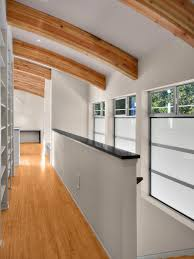contemporary half wall with architectural cap and railing