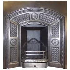 antique arts and craft burnished cast iron fireplace insert from a unique collection of antique