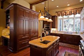 favored traditional kitchen ideas added small kitchen island with sink white marble top under classic pendant lights also brown wooden kitchen cabinets on