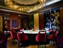 restaurant dining room design. A Round Dining Table Set Underneath Circle Of Hanging Lights And Next To Screens Restaurant Room Design