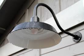 the american made gooseneck fixtures cast plenty of downward light onto the entryways and are equipped with a dusk to dawn photocell that allows the lights