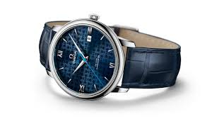 de ville orbis watch with a dark blue leather strap and dial engraved with teddy bears