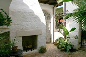 Small Picture Spanish courtyard with fireplace and circular paver pattern