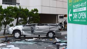 garage inside with car. Car Drives Off Parking Garage In Yokosuka, Killing Three And Injuring Two Inside With