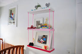 colorful cords that hang shelves on wall