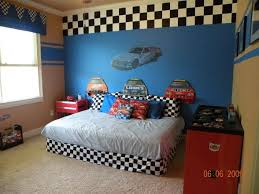 Race car bedroom I love the large checker border on the focal wall. I also