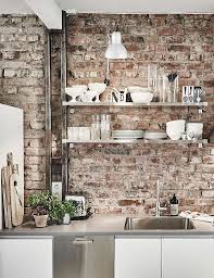BRICK WALL PAIRED WITH METALLIC WORK SURFACES