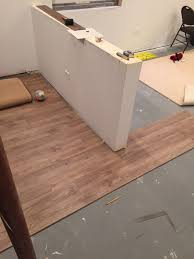 the version we chose driftwood oak with cork back allegedly needed no underlayment we could install directly on our concrete basement floor