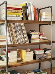 10 unique pairings of materials revolving around wood wood and pipes shelving unit