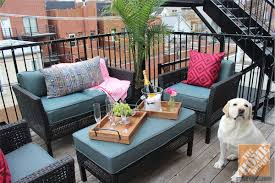 Balcony patio furniture Backyard Small Urban Balcony Is Decorated With Wicker Patio Furniture And Colorful Throw Pillows And The Home Depot Blog Small Urban Balcony Patio Decorating Ideas By Alex Kaehler