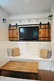small living room with sliding barn style doors for the television nook design