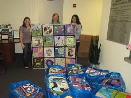Honey Bee Quilt Store: Quilts Delivered to Camp Braveheart & Anne Ellison from the Linus Connection and I went to Austin Hospice today  to deliver the quilts for Camp Braveheart. Here they are being received by  Doran ... Adamdwight.com