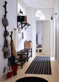 small hall furniture. a small hallway with two benches for shoes, mirror and tree-shaped hangers hall furniture r