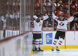 canada s markus phillips cody glasaxime comtois from left celebrate glass