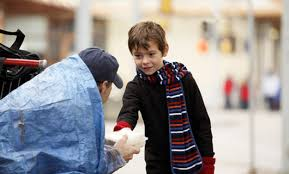Image result for boy gives homeless person