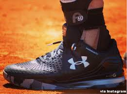 under armour tennis shoes. kinda ugly. i preferred the first black iteration he sported on clay, cosmetics wise. under armour tennis shoes n
