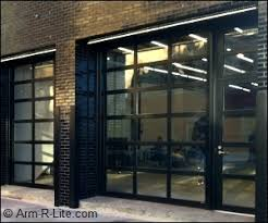 garage door with entry doorGlass Garage Door and Matching Entrance Door at Willardt Gallery
