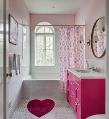 lovely pink girl s bathroom features a pink heart shaped bath rug placed on white marble honeycomb floor tiles in front of a hot pink washstand accented