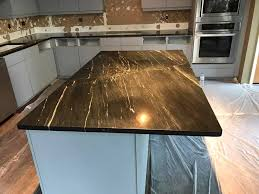 add luxury to your kitchen with black marble countertops