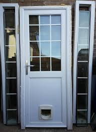 upvc back door with cat flap glass side panels and window