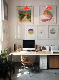 At home office Chic Home Office With Gallery Wall Of Colorful Paintings The Spruce 12 Beautiful Home Office Ideas