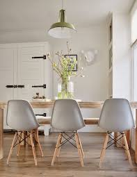 eames molded plastic chairs with dowel wood leg base farm table