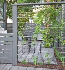 Cable Wires Mounted Between Fence Posts Create A Sturdy Support Climbing Plant Support