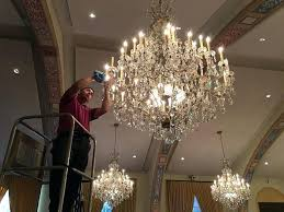 cleaning crystal chandelier beach cleaners tiered with faux wax candle covers chandeliers vinegar cleaning crystal chandelier