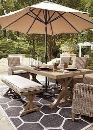 beachcroft dining table with umbrella