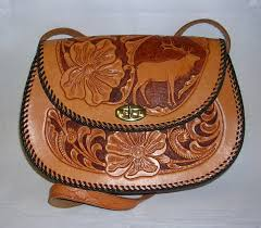 elk design hand tooled leather purse to expand