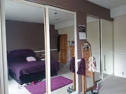four mirrored wardrobe door panels in the master bedroom