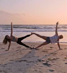 s practicing yoga on the beach